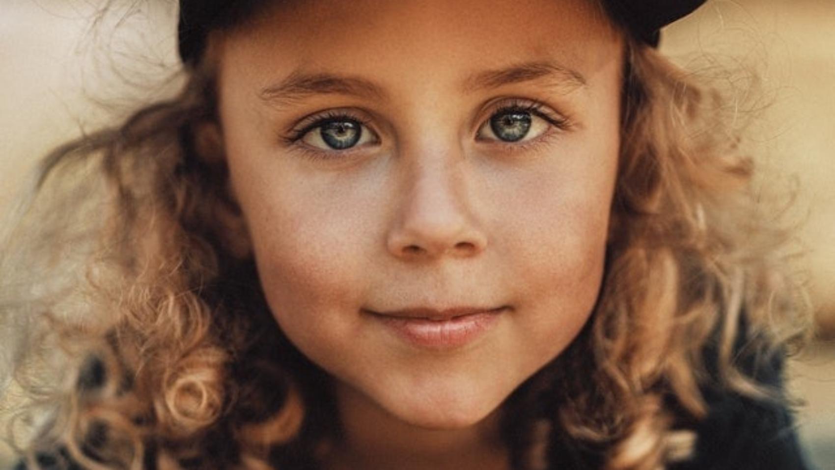 photo-of-girl-smiling-while-wearing-black-cap-4509051