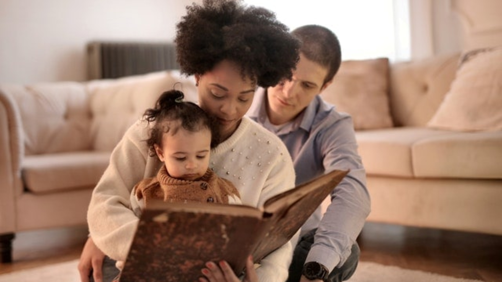 photo-of-woman-holding-brown-book-with-her-child-3818561