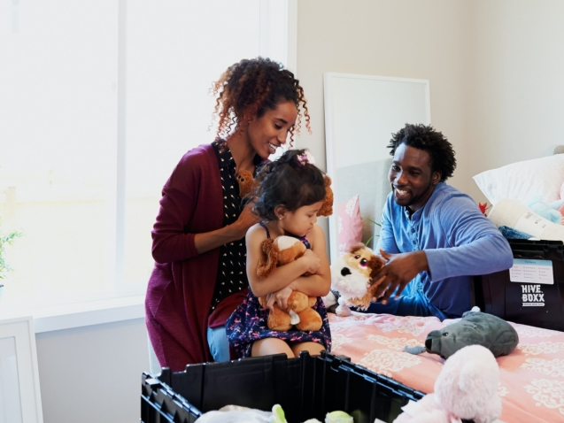 Two parents helping their kids with moving out and moving in.